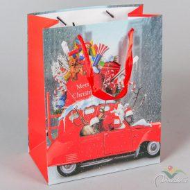 Papírtasak mikulás kocsiban,ajándékkal 18x23cm